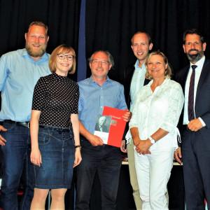 Jubilarehrung 2018 - Martin Aßmus (in der Mitte) umringt von den Laudatoren
